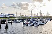 Sailboats in the harbor, Bensersiel, East Frisia, Lower Saxony, Germany