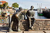 Fisherman sculptures in the harbor, old and young fishermen - sculptor Hans-Christian Petersen, Neuharlingersiel, East Friesland, Lower Saxony, Germany