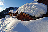 Snow-covered chalets on the Fafleralp in the rear Lötschental, Valais, Switzerland.