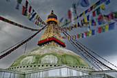 Monsoon clouds over the stupa of Bodnath, Kathmandu, Nepal, Asia.