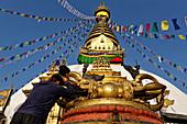 Pilgrims in front of the stupa of Swayambhunath, Kathmandu, Nepal, Asia.