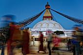 Pilgrims circle the Bodnath Stupa in Bodnath, Kathmandu, Nepal, Asia.