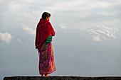 Nepalese woman in front of Annapurna, Pokhara, Nepal, Himalaya, Asia.
