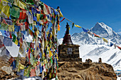 Buddhist prayer flags above Annapurna Base Camp, Nepal, Himalayas, Asia.