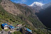 The village of Chomrong and the Annapurna South, Nepal, Himalaya, Asia.