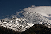 Full moonlight on the Annapurna South, Nepal, Himalayas, Asia.