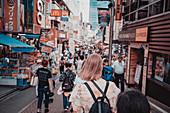 Harajuku Street with TouristIn foreground, Tokyo, Japan