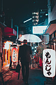 Businessman on his way home in Osaka, Japan