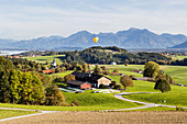 Hot air balloon, view of Greimharting, Ratzinger Höhe towards Chiemsee, Rimsting, Bavaria, Germany