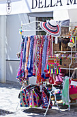 Exterior of a shop with colourful scarves and bags in Anacapri, Capri, Italy