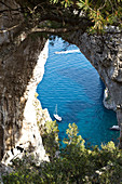 View at sea through the Arco Naturale in Capri, Italy
