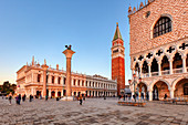 Palazzo Ducale (right), San Marco Tower and National Library (left) at sunrise in Venice, Veneto, Italy