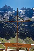 Bench with cross on the Fürenalp, Stäuber, Engelberg, Switzerland