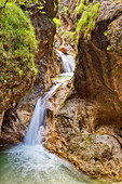 Waterfall in the Almbachklamm in the Berchtesgaden Alps, Bavaria, Germany