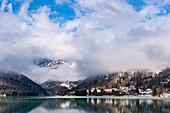 Winter lanscape of the samll touristic village of Barcis and its lake in the Friulian Dolomites. Italy