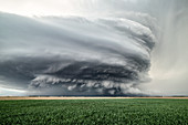 Sculpted super-cell, a mesocyclone weather formation thunderstorm clouds, drifting majestically across the Nebraska sand hills.