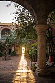 Convento de Santa Cruz de la Popa, historic convent building, courtyard with arches, cloisters and flowering shrubs