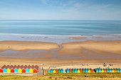 View of colourful beach huts on West Cliff Beach, Whitby, North Yorkshire, England, United Kingdom, Europe