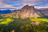 Aerial view of Sass De Putia (Peitlerkofel) and canyon surrounded by woods, Passo Delle Erbe, Dolomites, South Tyrol, Italy, Europe