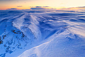 Fresh snow shaped by the cold Arctic wind blowing over mountains at dawn, Tana, Troms og Finnmark, Northern Norway, Scandinavia, Europe