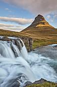 One of Iceland's iconic landscapes, Mount Kirkjufell and Kirkjufellsfoss Falls, near Grundarfjordur, Snaefellsnes peninsula, Iceland, Polar Regions