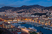 Elevated view from Castle Hill down to Port Lympia at dusk, Nice, Alpes Maritimes, Cote d'Azur, French Riviera, Provence, France, Mediterranean, Europe