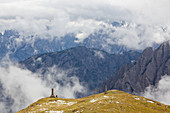 Walkers and monuments, Trentino-Alto Adige, South Tyrol in Bolzano district, Alta Pusteria, Hochpustertal,Sexten Dolomites, Italy