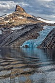 LANDSCAPE WITH A BLUE-COLORED GLACIER'S ICE TONGUE, ASTORIA CRUISE SHIP, PRINCE CHRISTIAN SOUND, GREENLAND