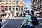 CYCLIST WITH A MASK, PLACE DE LOPERA DURING THE COVID-19 PANDEMIC LOCKDOWN, PARIS, ILE DE FRANCE