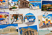 Souvenirs, colourful plaques of tourist destinations in Greece.