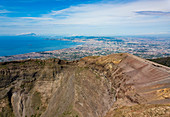 Aerial view of Mount Vesuvius crater with the Bay of Naples behind, Campania, Italy, Europe