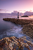 Sunrise over Penmon Point lighthouse, Anglesey, North Wales, United Kingdom, Europe