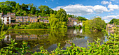 View of reflections in Cromford pond, Cromford, Derbyshire Dales, Derbyshire, England, United Kingdom, Europe