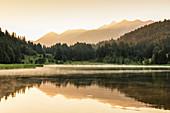 Geroldsee Lake against Karwendel Mountains at sunrise, Klais, Werdenfelser Land, Upper Bavaria, Germany, Europe