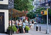 Group of People Gathered on Sidewalk in front of Restaurant, New York City, New York, USA