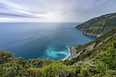 the colors of a spring sunset during a storm along the Cinque Terre coast, taken from a steep path, National Park of Cinque Terre, municipality of Riomaggiore, La Spezia province, Liguria district, Italy, Europe