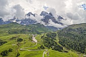 Aerial view taken from the drone of the road that goes up to Passo Rolle during a summer day, Natural Park Paneveggio-Pale di San Martino, Dolomites, municipality of Primiero San Martino di Castrozza, province of Trento, district of Trentino Alto Adige, Italy, Europe