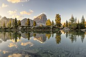 the tofana de rozes is reflected in the clear waters of Lake Limides in a summer sunset, Dolomites, municipality of Cortina d'Ampezzo, Belluno province, Veneto district, Italy, Europe