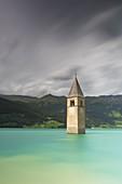 The bell-tower of Graun in Vinschgau, Reschensee - Lago di Resia, Bolzano, South Tyrol, Trentino Alto Adige, Italy, Europe