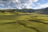 aerial view of the Fosso dei Mergani during a summer day, Sibillini mountain, Castelluccio di Norcia, municipality of Norcia, Perugia province, Umbria district, Italy, Europe