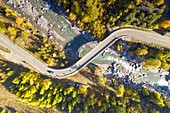 aerial view of the road that crosses the Cogne valley in autumn day, municipality of Cogne, Aosta province, Valle d'Aosta district, Italy, Europe