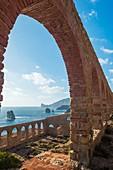 Italy, Sardinia, Sulcis-Iglesiente, Nebida.\nLamarmora ruins with Pan di Zucchero on the horizon.