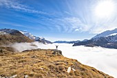 Alpinist in high Orco Valley, Gran Paradiso National Park, Piedmont, Graian alps, Italian alps, Italy