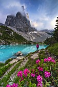 A girl observes sunset at Sorapiss lake in front of God finger, Cortina di Ampezzo, Belluno, Veneto, Italy, Southern Europe