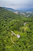 Aerial view of the old medieval fortress called Rocca di Orino in the Campo dei Fiori regional park. Orino, Valcuvia, Varese district, Lombardy, Italy.