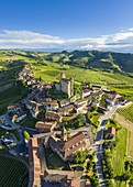 Aerial view of the medieval town of Serralunga d'Alba and its castle. Serralunga d'Alba, Langhe, Piedmont, Italy, Europe.