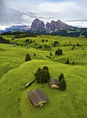 Aerial view of the Alpe di Siusi/Seiser Alm, a dolomite plateau and the largest high-altitude alpine meadow in Europe, at sunset. Castelrotto, South Tyrol, Trentino Alto Adige, Italy, Europe.