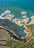 Aerial view of the natural sea rock arch of S'Archittu, Santa Caterina di Pittinuri, Cuglieri, Oristano district, Sardinia, Italy.