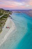 Aerial view of Stintino with La Pelosa and la Pelosetta beach and Capo Falcone. Stintino, Asinara Gulf, Sassari, Sardinia, Italy.