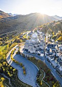 Aerial view of the Santuario della Madonna del Sangue sanctuary in the town of Re during an autumnal sunset. Re, Valle Vigezzo, val d'Ossola, Verbano Cusio Ossola, Piedmont, Italy.